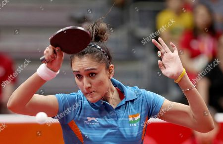 India's Manika Batra plays a return while playing Charlotte Carey of Wales during their women's team match the 2018 Commonwealth Games at the Oxenford Studios on the Gold Coast, Australia