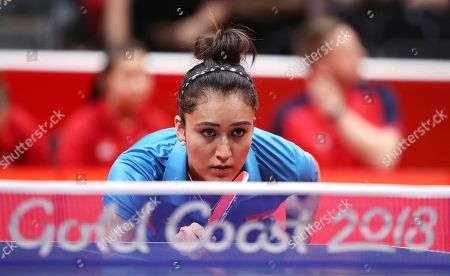India's Manika Batra prepares to return serve while playing Charlotte Carey of Wales during their women's team match the 2018 Commonwealth Games at the Oxenford Studios on the Gold Coast, Australia