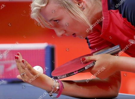 Charlotte Carey of Wales prepares to serve to India's Manika Batra during their women's team match the 2018 Commonwealth Games at the Oxenford Studios on the Gold Coast, Australia