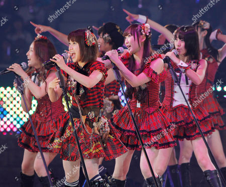 Stock Picture of Yuko Oshima, Tomomi Itano, Rino Sashihara. Yuko Oshima, second from left, Tomomi Itano, left, Rino Sashihara, third from right, and other members of Japan's most popular girl group AKB48 perform during a special event in Tokyo