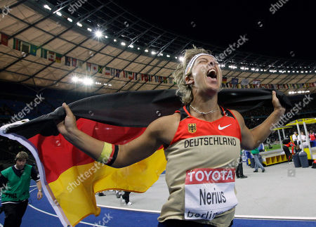 Germany's gold medal winner Steffi Nerius celebrates after the Women's Javelin final during the World Athletics Championships in Berlin on