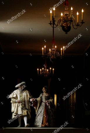 Costumed interpreters Richard Evans, left, as Britain's King Henry VIII and Kathryn Nutbeem, left, as the king's sixth wife Katherine Parr, seen, at Hampton Court Palace, on the outskirts of London, . During 2009 King Henry VIII's most famous royal residence plays host to 'Henry VIII: heads and hearts' a year-long programme of events and celebratory activities to mark the Tudor monarch's accession to the throne