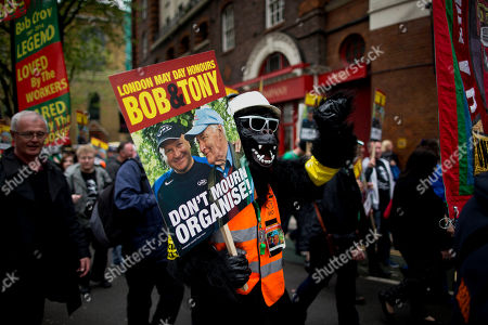 A demonstrator dressed in a gorilla costume takes part in a May Day Trades Unions workers' rights protest march in London, . This year's annual May Day protest had special emphasis on paying tribute to the lives of Bob Crow, the late general secretary of Britain's Rail, Maritime and Transport union and socialist politician Tony Benn who both died recently