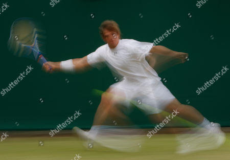 Igor Andreev of Russia reaches for a shot from Vincent Spadea of U.S., during their second round singles match at Wimbledon