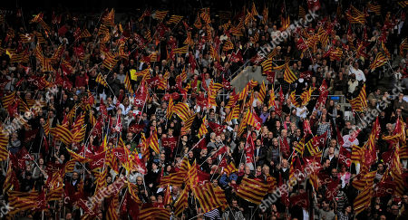 Supporters wave Catalan flags during the speech of president Jose Montilla of the Catalan Socialist party (PSC) during a meeting in Barcelona, Spain, . In Catalonia's elections, many see the beginning of the end of the Socialists' grip on power in Spain. Zapatero's party is expected to suffer a big loss in the rich northeastern region's weekend ballot _ punishment for the country's economic woes that could snowball into a string of setbacks culminating in defeat in national elections in 2012