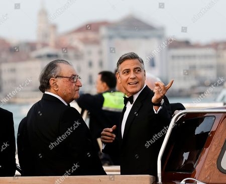 Stock Image of George Clooney, Ramzi Alamuddin. Actor George Clooney, right, talks to Ramzi Alamuddin, father of her fiancee Amal Alamuddin, on a boat carrying them to the Aman hotel ahead of his wedding in Venice, Italy
