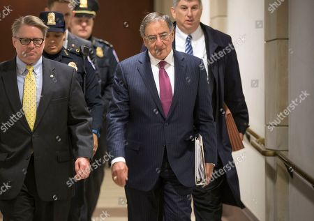 Former Defense Secretary Leon Panetta, center, is escorted to a secure floor on Capitol Hill in Washington, to be questioned in a closed-door hearing of the House Benghazi Committee. The panel, chaired by Rep. Trey Gowdy, R-S.C., is investigating the 2012 attacks on the U.S. consulate in Benghazi, Libya, where a violent mob killed four Americans, including Ambassador Christopher Stevens