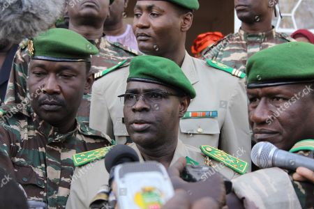 Gen. Salou Djibo, center, head of the military junta that has ruled Niger since a February 2010 coup, speaks to the press after voting in Niamey, Niger, . This impoverished country on the edge of the Sahara took another stab at democracy Monday when it voted for a new president and parliament that are expected to take over leadership from the military