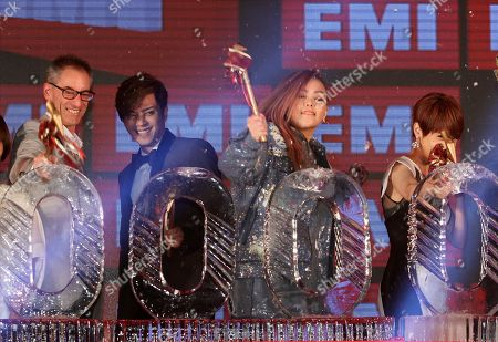 A-mei, Rainie Yang, Show Lo, George Ash. Taiwanese singers, from right, Rainie Yang, A-mei, and Show Lo, break ice blocks with Universal Music Asia Pacific President George Ash during a media event to announce they join EMI Music, in Taipei, Taiwan
