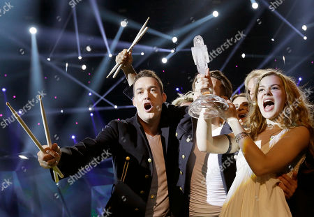 """Winner of the 2013 Eurovision Song Contest Emmelie de Forest of Denmark who sang """"Only Teardrops,"""" celebrates with the trophy after the final at the Malmo Arena in Malmo, Sweden, . The contest is run by European television broadcasters with the event being held in Sweden as they won the competition in 2012"""