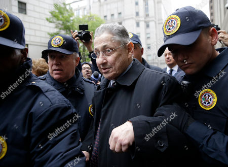 Former Assembly Speaker Sheldon Silver leaves court surrounded by reporters in New York, . Silver was sentenced to 12 years in prison Tuesday, capping one of the steepest falls from grace in the state's lineup of crooked politicians for a consummate backroom dealer who wielded power for over two decades