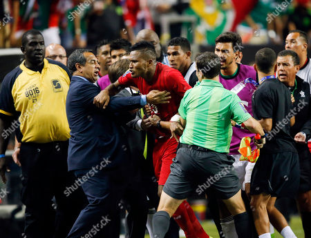 Panama's Erick Davis (15) is restrained as tempers flare during the second half of a CONCACAF Gold Cup soccer semifinal between Panama and Mexico, in Atlanta. Mexico won 2-1 in extra time