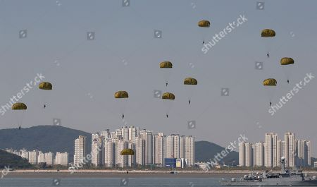 Stock Photo of South Korean soldiers parachute down during the 65th Incheon Landing Operations Commemoration ceremony in waters off Incheon, South Korea, . Incheon is the coastal city where the United Nations Forces led by U.S. General Douglas MacArthur landed in September, 1950 just months after North Korea invaded the South