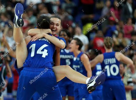 Clemence Beikes, Emmeline Ndongue. France's Clemence Beikes smiles as she leaps into the arms of teammate Emmeline Ndongue (14) after beating Russia during a women's semifinals basketball game at the 2012 Summer Olympics, in London