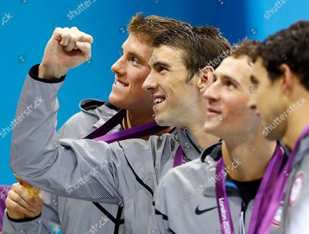Michael PhelpsConor Dwyer, Ricky Berens, Ryan Lochte. United States' Conor Dwyer, left, Michael Phelps, center, Ryan Lochte, second right, and Ricky Berens, right, pose with their gold medals after their win in the men's 4 x 200-meter freestyle relay at the Aquatics Centre in the Olympic Park during the 2012 Summer Olympics in London