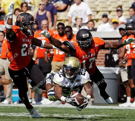 Clinton Lynch, Zach Jackson, Eric Jackson. Georgia Tech's Clinton Lynch (22) dives for a pass but cannot hang onto the ball while defended by Mercer's Zach Jackson, left, and Eric Jackson in the first half of an NCAA college football game in Atlanta