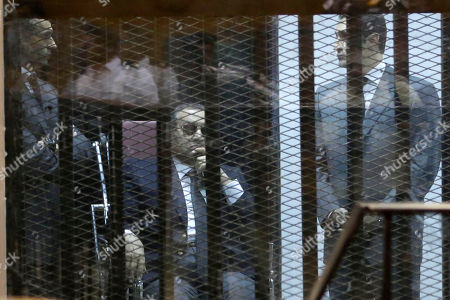 """Hosni Mubarak, Gamal Mubarak, Alaa Mubarak. Former Egyptian President Hosni Mubarak, seated, and his two sons Gamal Mubarak, left, and Alaa Mubarak, right, attend the verdict of the corruption case dubbed by the Egyptian media as the """"presidential palaces"""" affair concerning charges that Mubarak and his two sons embezzled millions of dollars' worth of state funds over the course of a decade in a courtroom in Cairo, Egypt, . Egypt's deposed leader Hosni Mubarak and his two sons were sentenced Saturday to three years in prison and a fine in a retrial on corruption charges they faced earlier. It wasn't immediately clear whether it will include time he's already served since his country's 2011 revolt"""