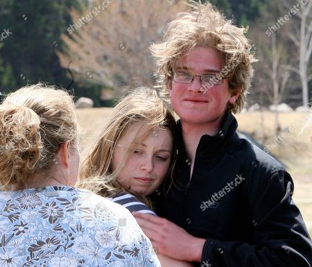 Scott Mason gets a hug from his sister Amy Mason after spending three nights lost in the White Mountains in Pinkham Notch, N.H