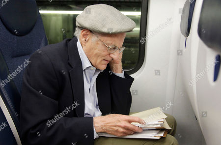 American economist Thomas Sargent takes a phone call while seated on a train in New York, shortly after learning that he and fellow American Christopher Sims had won the Nobel Prize for Economics. Sargent, a professor at New York University, was heading to Princeton, N.J., where he teaches a class at Princeton University. Sargent and Sims won the Nobel economics prize on Monday for research that sheds light on the cause-and-effect relationship between the economy and policy instruments such as interest rates and government spending