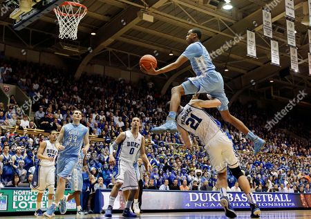 John Henson, Miles Plumlee, Tyler Zeller, Austin Rivers, Seth Curry. North Carolina's John Henson jumps over Duke's Miles Plumlee (21) for a shot during the first half of an NCAA college basketball game in Durham, N.C., . At rear, Duke's Seth Curry and Austin Rivers (0) watch with North Carolina's Tyler Zeller (44