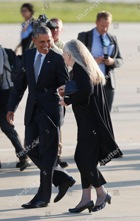 Stock Photo of Barack Obama, Marilynne Robinson. Pulitzer Prize winning Iowa writer Marilynne Robinson, right, says goodbye to President Barack Obama before he boards Air Force One at Des Moines International Airport in Des Moines, Iowa, to fly to Andrews Air Force Base, Md. While in Iowa, Obama gave an interview with Robinson and spoke about college access and affordability at North High School
