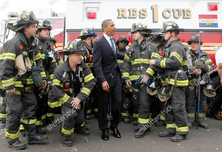 President Barack Obama meets with New York City firefighters after he landed in Marine One helicopter in lower Manhattan in New York, before traveling to Lincoln Center where he will speak at a memorial service for the late CBS News anchorman Walter Cronkite