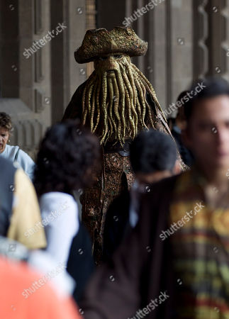 Stock Image of A street performer dressed as Davy Jones, a fictional character from Pirates of the Caribbean, walks among the crowds near Mexico City's main plaza, the Zocalo, . Street performers, many dressed in costumes, gathered to protest in the historic downtown area where once they were allowed to perform but are now run off by police
