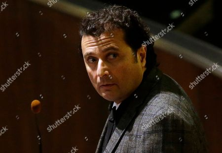 Francesco Schettino attends his trial at the Grosseto court, Italy, . The captain of the capsized Costa Concordia luxury liner has been convicted of multiple charges of manslaughter and sentenced to 16 years in jail. Francesco Schettino wasn't present when Judge Giovanni Puliatti read out the verdict Wednesday night in a Grosseto theater. The verdict and sentencing brought a close to a trial that has been running since July 2013