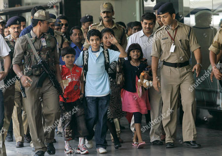 """Ayush Khedekar, Tanay Hemant Chheda, Tanvi Lonkar, Rubina Ali Qureshi. The child actors of the film """"Slumdog Millionaire"""" from left, Ayush Khedekar, Tanay Hemant Chheda, Tanvi Lonkar, and Rubina Ali Qureshi arrive at the international airport in Mumbai, India, . """"Slumdog Millionaire"""", a tale of hope amid adversity and squalor in Mumbai, came away with eight Oscars, including best picture and director for Danny Boyle"""