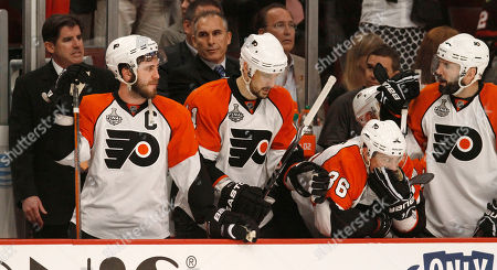 Mike Richards, Blair Betts, Darroll Powe, Ian Laperriere, Joe Quenneville. Philadelphia Flyers players Mike Richards, left, Blair Betts (11), Darroll Powe (36), and Ian Laperriere, right, watch from the bench in the final minutes of the third period of their 7-4 loss to the Chicago Blackhawks in Game 5 of the NHL Stanley Cup hockey finals, in Chicago. At far left is head coach Joe Quenneville. The Blackhawks lead the series 3-2