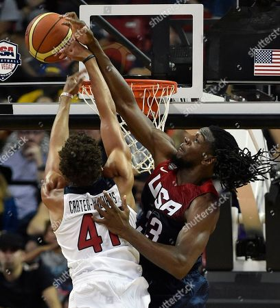 Stock Photo of Kenneth Faried, Michael Carter-Williams. Kenneth Faried, right, draws a foul as he blocks a shot by Michael Carter-Williams during a U.S. men's basketball intrasquad game, in Las Vegas
