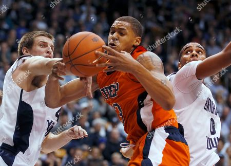 Chris Collinsworth, Brandon Davies, Gabriel McCulley. BYU's Chris Collinsworth, left, and Brandon Davies, right, fight for a rebound with UTEP's Gabriel McCulley during the second half of an NCAA college basketball game in Provo, Utah, . BYU won 89-68