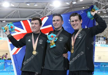 New Zealand's Ethan Mitchell, Eddie Dawkins and Sam Webster pose after winning gold at the Men's Team Sprint at the Anna Meares Velodrome during the 2018 Commonwealth Games in Brisbane, Australia