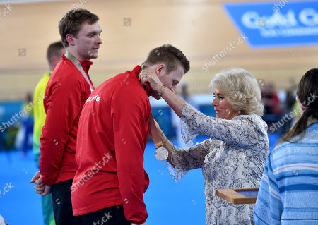 Camilla Duchess of Cornwall presents silver medals to James Ball and Peter Mitchell of Wales at the Commonwealth Games Cycling finals at the Anna Meares Velodrome