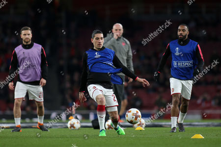 Hector Bellerin of Arsenal warms up pre-match as Steve Bould looks on during Arsenal vs CSKA Moscow, UEFA Europa League Football at the Emirates Stadium on 5th April 2018