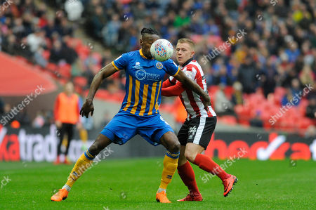 Stock Photo of Danny Martin Rowe of Lincoln City and Omar Beckles of Shrewsbury Town in action during the Checkatrade Trophy Final between Lincoln City and Shrewsbury Town at Wembley Stadium in London. 08 Apr 2018