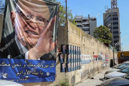 Posters depicting a photo for former prime minister Tammam salam with photos of candidates for Lebanese parliamentary elections from competing lists posted on a Beirut street, Lebanon 05 April 2018. A total of 976 candidates have presented to the Ministry of Interior affairs of those, 111 candidates are women. This year's elections has the highest number of candidates ever recorded. The previous record was 702, in 2009. The 06 May 2018 general elections will be Lebanon's first in nine years.