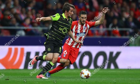 Fabio Coentrao of Sporting Lisbon and Koke of Atletico Madrid in action