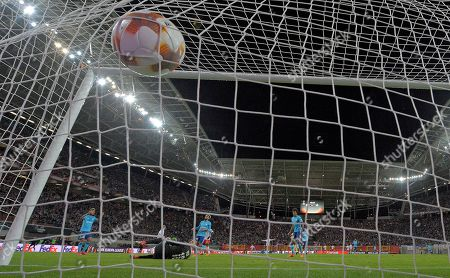 Marseille goalkeeper Yohann Pele receives the opening goal from Leipzig's Timo Werner during the Europa League quarterfinal soccer match between RB Leipzig and Olympique Marseille in Leipzig, Germany