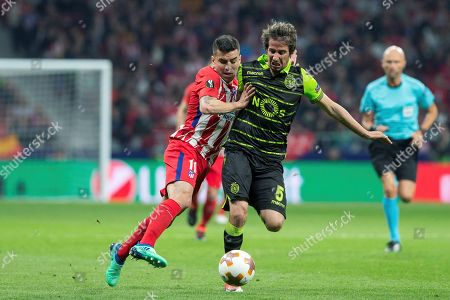 Atletico Madrid's Angel Correa (L) and Sporting's Fabio Coentrao (R) in action during the UEFA Europa League quarter final first leg soccer match between Atletico Madrid and Sporting CP at Wanda Metropolitano stadium in Madrid, Spain, 05 April 2018.