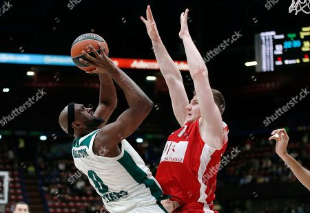 Stock Image of Panathinaikos' Andrew Goudelock, left, goes for the basket with Olimpia Milan's Arturas Gaudaitis during the Euro League basketball match between Olimpia Milan and Panathinaikos, in Milan, Italy