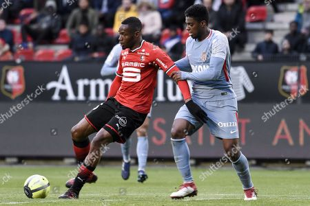 Rennes s player Diafra Sakho fights for the ball with Monaco s player De Jesus Nascimento Jemerson