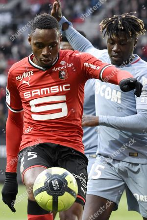 Rennes s player Diafra Sakho fights for the ball with Monaco s player Kevin N Doram