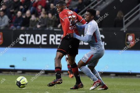 Rennes s player Diafra Sakho fights for the ball with Monaco s player Jemerson