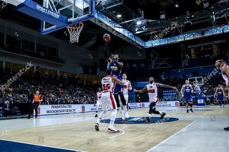 Thomas Robinson, #0 of Moscow Khimki shoots a shot against #55 Curtis Jerrells of Armani Milan