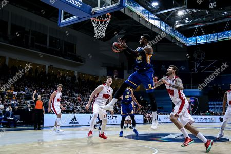 Thomas Robinson, #0 of Moscow Khimki goes up for a shot under the basket against Vladimir Micov, #5 of Armani Milan