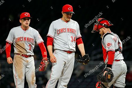 Homer Bailey, Scooter Gennett, Tucker Barnhart. Cincinnati Reds starting pitcher Homer Bailey (34) with Scooter Gennett (3) and catcher Tucker Barnhart for manager Bryan Price to make his way to the mound to remove Bailey from the team's baseball game against the Pittsburgh Pirates during the fifth inning in Pittsburgh