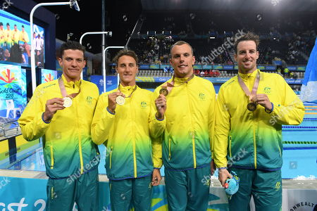 Stock Photo of (L-R) Gold medalists Jack Cartwright, Cameron McEvoy, Kyle Chalmers and  James Magnussen of Australia pose for a photograph after the medal ceremony of the Men's 4x100m Freestyle Relay final on day two of swimming competition at the XXI Commonwealth Games at Gold Coast Aquatic Centre on the Gold Coast, Australia, 06 April 2018.