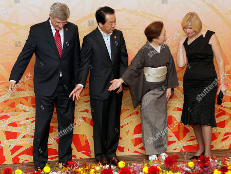 Naoto Kan, Nobuko Kan, Stephen Harper, Laureen Harper. Canadian Prime Minister Stephen Harper, left, and his wife Laureen, right, are welcomed by Japanese Prime Minister Naoto Kan and his wife Nobuko at the start of a cultural event at the APEC forum in Yokohama, Japan