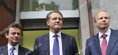 Members of the British Petroleum executive, from left, outgoing CEO Tony Hayward, Chairman Carl-Henric Svanberg, and incoming CEO Bob Dudley, pose for the media outside their global headquarters in London, . The company announced that Hayward, BP's much-criticized CEO will be replaced by American Robert Dudley on Oct. 1, as it reported a record quarterly loss and set aside $32.2 billion to cover costs of the devastating Gulf of Mexico oil spill. BP said the decision to replace Hayward, 53, with the company's first ever non-British chief executive was made by mutual agreement